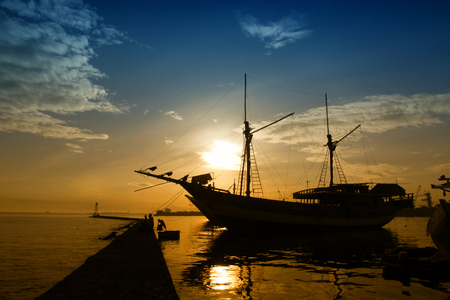 silhouette Phinisi ship - Traditional wooden sailing ships at Paotere Harbor