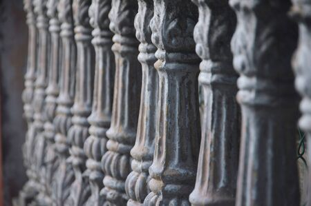gray concrete fence pillars lined up with selective focus Standard-Bild
