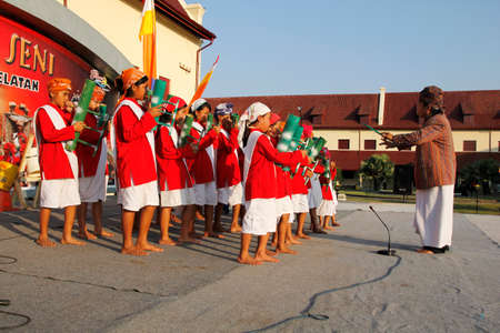MAKASSAR - INDONESIA, 17 MAY 2012 : the appearance of Toraja children playing wind music called Passuling