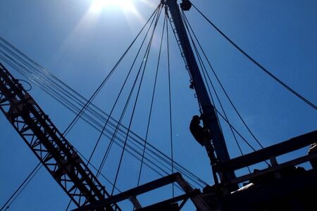 silhouette wooden ship against blue sky
