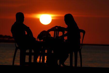 silhouette of a couple on the Losari beach Makassar  Indonesia 免版税图像