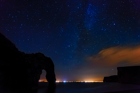 dorset: Dorset nightscape with the milky way and a pereside meteor Stock Photo