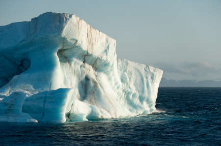 A large iceberg drits at sea in Arctic Ocean having detached from a glacier.Climate Crisis