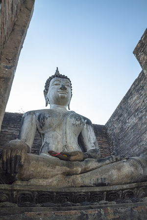associated: Big buddha statue and Ancient building at Historic Town of Sukhothai and Associated Historic Towns in Sukhothai, Thailand Stock Photo