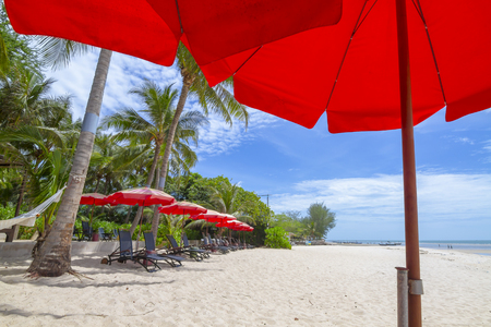 umbella: Relaxing on remote red umbrella protect sunlight day time and chair beach under blue sky and cloud ,ocean sea Thailand