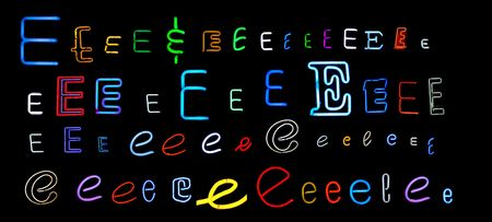 collection of a number of different neon letter E isolated on black - part of a series of neon letters photo