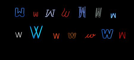 collection of a number of different neon letter w isolated on black - part of a series of neon letters photo