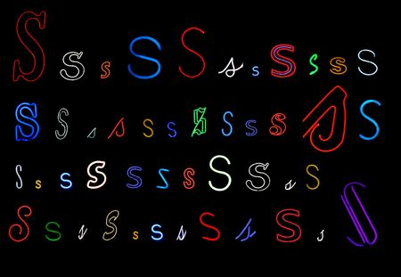 collection of a number of different neon letter S isolated on black - part of a series of neon letters