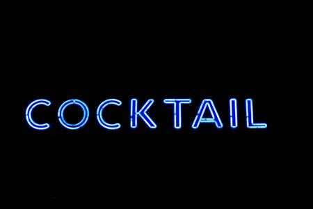 neon cocktail sign isolated on black photo