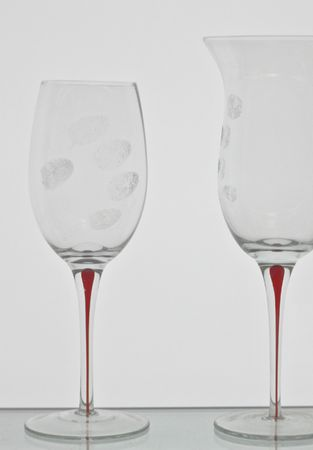 wine glasses isolated on whitewith finger prints Stock Photo