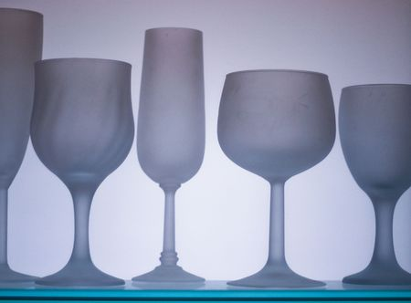 collection of frosted wine glasses isolated on white