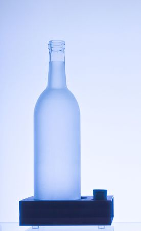 frosted glass wine bottle on a stand Stock Photo