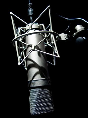 vintage microphone isolated on black Stock Photo