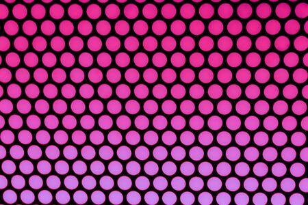 purple polka dot background pattern on black Stock Photo
