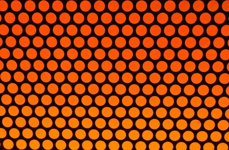 orange polka dot background pattern on black photo