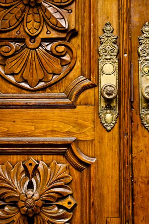 close up of a vintage wooden front door with brass fittings Stock Photo
