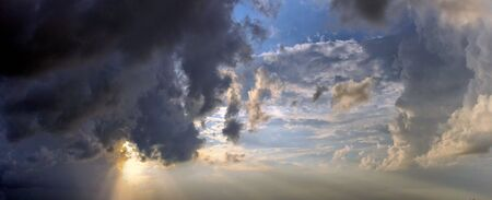 panorama of a spectacular storm moving in front of the sun Stock Photo