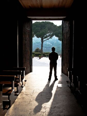 silhouette of a man and shadow in a doorway Stock Photo