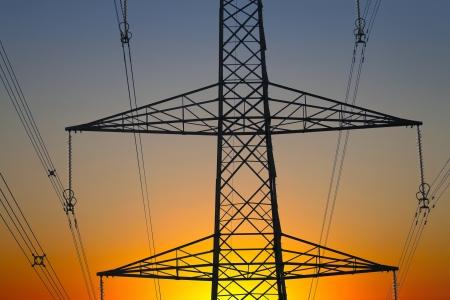 close up of an electricity pylon at sunset  Stock Photo