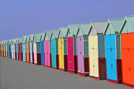 row of colored beach huts with blue sky background  photo