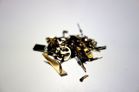 Gilded electronic and mechanical waste Stock Photo