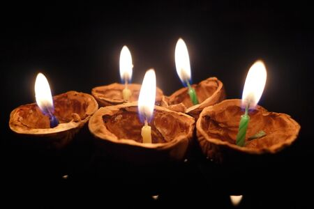 Burning candles on a floating shell, Christmas