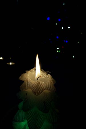 Burning candle in the dark settings Stockfoto