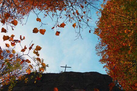 Symbolic cross on the rock