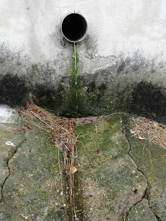 Rainwater flowing out of the plastic pipe