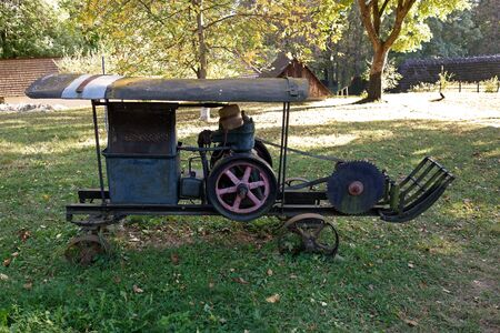An old motor saw on wheels