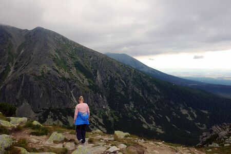 Tourist admiring High Tatras 写真素材