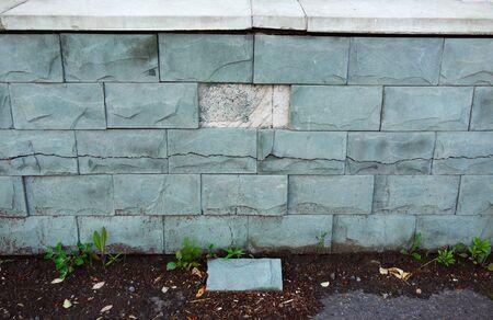 Concrete fence, damaged