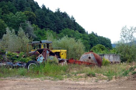Abandoned old corroded cars in the countryside