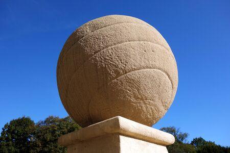 Concrete ball on concrete stand