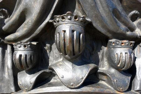 Cast steel sculpture with three heads of kings in military armor