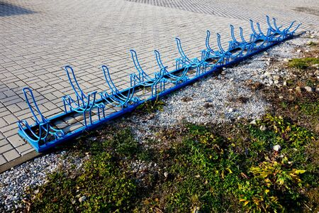 Metal bicycle stand in the city 写真素材