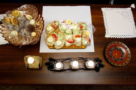 The feast table with food and candles