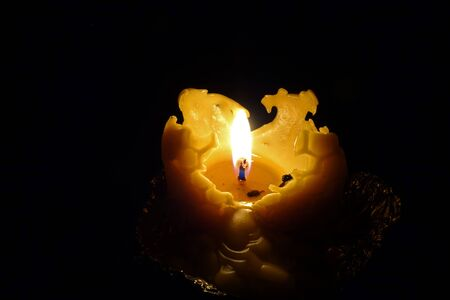 Burning Christmas candle cast from beeswax