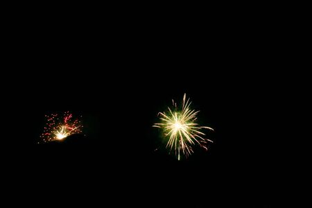 Fireworks explosions on dark background. New Years Eve celebrations 写真素材