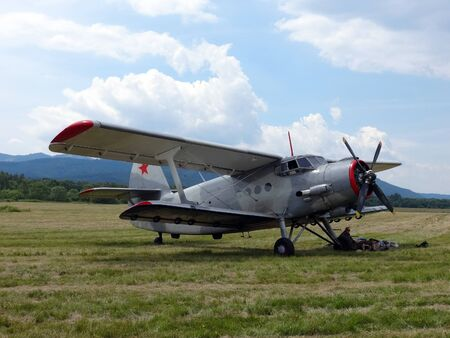 Poprad, Slovakia - JULY 29, 2014: Relaxation pilots below wing aircraft Antonov An- 2 on air show.