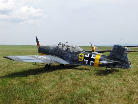 Poprad, Slovakia - JULY 29, 2014: Camouflage aircraft Bf-109  Zlin Z- 226 on air show at the airport Poprad.