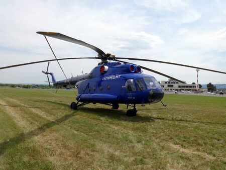 Poprad, Slovakia - JULY 29, 2014: Helicopter MI- 8T in blue settle air show.Helicopter MI-8T on grassy plane airport on air show.