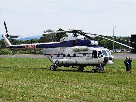Poprad, Slovakia - JULY 29, 2014: Helicopter the Department of Home Affairs Slovakias republic MI-17 on grassy plane airport on air show.