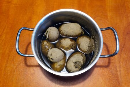 Cooked potatoes in a pot 写真素材