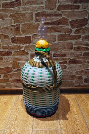 Carboy with wine and fermentation cap