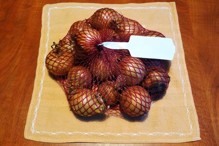 Raw onion with peel to prepare delicious meals