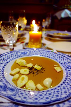 Garlic with honey on plates, traditional food on Christmas Eve
