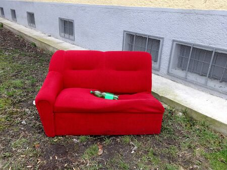 Abandoned old and red couch