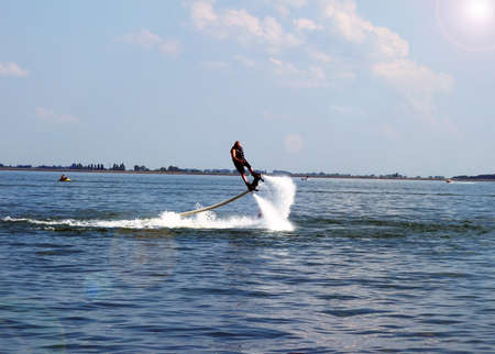 Water sport Flyboard on water during summer vacation 免版税图像