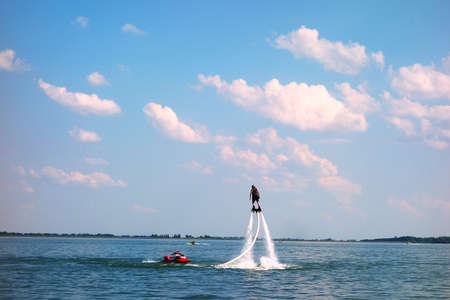 Water sport Flyboard on water during summer vacation Stock Photo